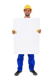 Construction worker holding blank white sign stock photo