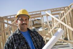 Construction Worker Holding Blueprint Stock Photo