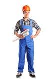 Construction worker holding blueprints Stock Image