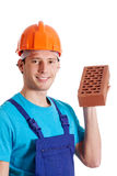 Construction worker holding a brick Stock Photos