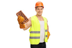 Construction worker holding a brick Stock Images