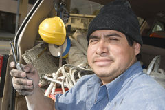 Construction Worker Holding Cell Phone Stock Image