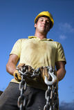 Construction Worker Holding Chain stock photo