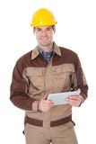 Construction worker holding digital tablet Royalty Free Stock Photos