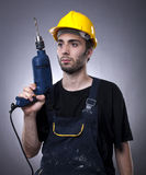 Construction worker holding a drill Royalty Free Stock Photo