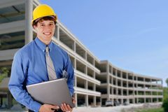 Construction Worker Holding Laptop Royalty Free Stock Images