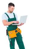 Construction worker holding laptop Stock Images