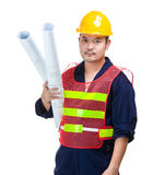 Construction worker holding layout drawing Stock Images