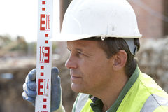Construction Worker Holding Measure Royalty Free Stock Photo