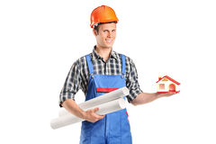 Construction worker holding a model of house Royalty Free Stock Photo