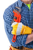 Construction worker holding monkey wrench in hand Royalty Free Stock Images