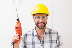 Construction worker holding power drill. In a new house Royalty Free Stock Images