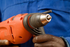 Construction worker holding a power tool Stock Images