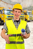 Construction worker holding project documents. Close up of a construction worker holding project documents and welcoming client Royalty Free Stock Photography