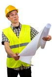Construction worker holding project documents. Isolated on white background Stock Image