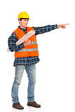 Construction worker holding rolled paper plan and pointing. Royalty Free Stock Photo