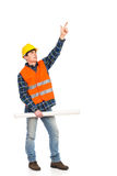 Construction worker holding rolled paper plan and pointing up. Stock Photo