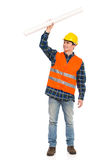 Construction worker holding rolled paper plan. Stock Photos