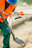Construction worker holding shovel Royalty Free Stock Images