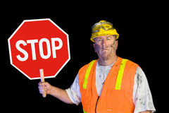 Construction worker holding stop sign Stock Images
