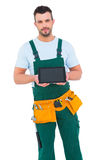 Construction worker holding tablet pc. On white background stock images