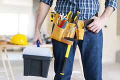 Construction worker holding a toolbox royalty free stock images