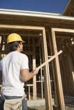 Construction Worker Holding Wooden Beam Stock Images