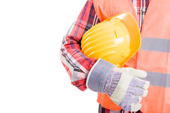 Construction worker holding yellow helmet under his arm Royalty Free Stock Photo