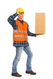 Construction worker holds carton box on one hand. Stock Images