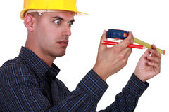 A construction worker impressed. By his meter royalty free stock images