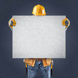 Construction worker with information posters Royalty Free Stock Image