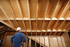 Construction worker inspecting home addition. Stock Image