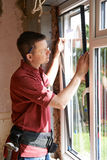Construction Worker Installing New Windows In House Royalty Free Stock Image