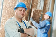 Construction worker at insulation work Royalty Free Stock Photography