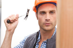 Construction Worker on the job. A Construction Worker on the job with a hard hat Royalty Free Stock Image