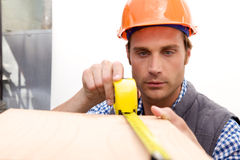 Construction Worker on the job. A Construction Worker on the job with a hard hat Royalty Free Stock Photography