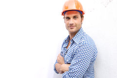 Construction Worker on the job. A Construction Worker on the job with a hard hat Stock Image