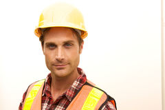 Construction Worker on the job. A Construction Worker on the job with a hard hat Stock Photography