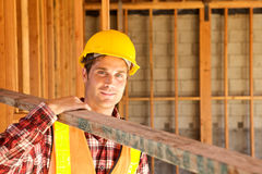 Construction Worker on the job. A Construction Worker on the job with a hard hat Royalty Free Stock Photo