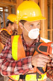 Construction Worker on the job. A Construction Worker on the job with a hard hat Royalty Free Stock Images