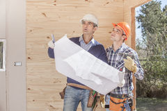Construction Worker on the job. Looking at blueprints Royalty Free Stock Photos
