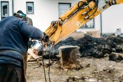 Worker, laborer, welding excavator arm with arc welding machinery. Construction worker, laborer, welding excavator arm with arc welding machinery stock images