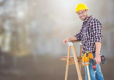 Construction Worker on ladder in front of construction site. Digital composite of Construction Worker on ladder in front of construction site Royalty Free Stock Photos