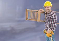 Construction Worker with ladder in front of construction site Stock Image