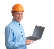 Construction worker with a laptop Stock Photo