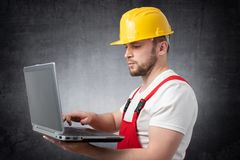 Construction worker with laptop stock photography