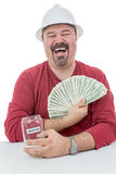 Construction worker laughing with vacations money Royalty Free Stock Photo