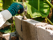 Construction worker laying brick of a wall Royalty Free Stock Photography