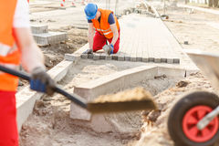 Construction worker laying cobblestones Royalty Free Stock Photography