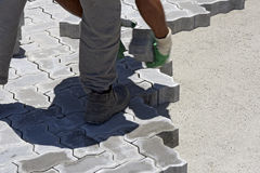 Construction worker laying concrete tiles Stock Photography